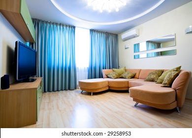 Modern room interior with TV and sofa