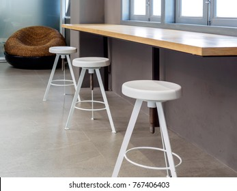 Modern round stool with wooden counter top in chic Cafe / Home decoration & renovation concept