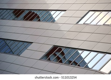 The modern row of windows and facades of an office and business building / Modern office building