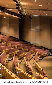 Modern rows of chairs in large assembly hall in university