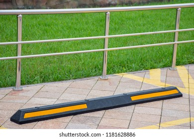 Modern rubber barrier fencing for cars in summer parking in the street