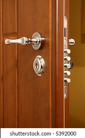 The modern and safe lock on a wooden door