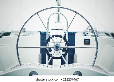 a modern sailing yacht steering wheels
