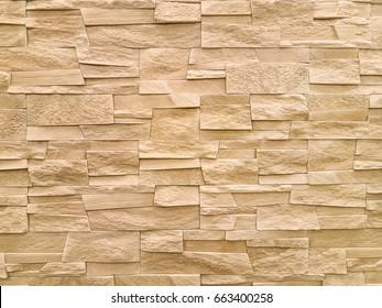Modern sandstone stone wall background texture.