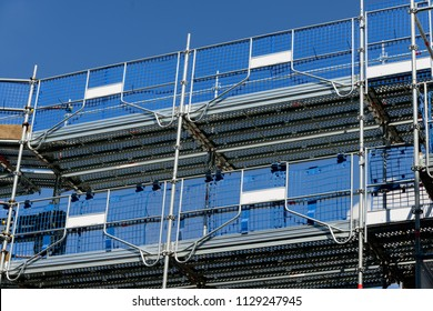 A modern scaffold system in use at a construction site.