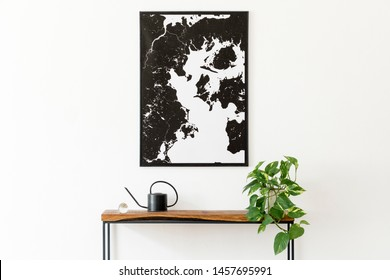 Modern scandinavian interior of living room with wooden console,  plant, black watering can and elegant personal accessories. Stylish mock up poster map. Design home decor. Template.  Minimalistic.