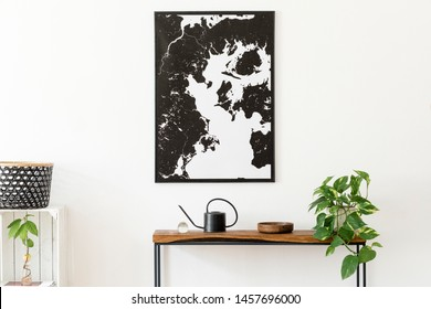 Modern scandinavian interior of living room with wooden console,  plant, black watering can, basket and elegant personal accessories. Stylish mock up poster map. Design home decor. Template.