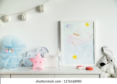 The modern scandinavian newborn baby room with mock up poster frame, white clouds, pink star, white rabbit and cotton lamps .