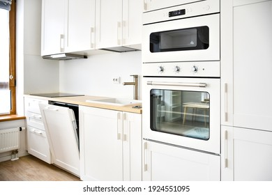 Modern Scandinavian-Style kitchen or living room, minimalist interior design, oven, microwave and sink with wooden board, table and chairs, dishwasher, white and wooden color, furniture