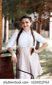 Modern schoolgirl outdoors. Schoolgirl happy smiling pupil with long braided braids. Beginning of academic year. Adorable schoolgirl. Time to study. School fashion.  Girl wearing in a school uniform.