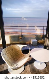 Modern seat and chairs overlooking the sea