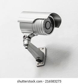 Modern security camera fix on the indoor concrete wall