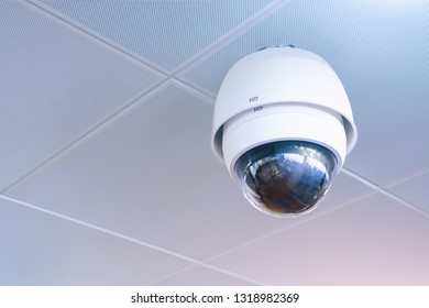 Modern security CCTV(closed-circuit television) camera with copy space at ceiling of the office.Technology system for protection from theft.Digital eye.Surveillance