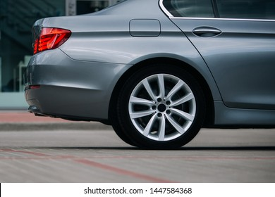 Modern sedan car rear wheel and rim