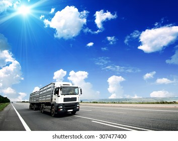 Modern Semi Truck in Motion. American Highway Trucking. Summer on the Highway