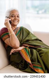 Modern senior Indian woman talking on the phone