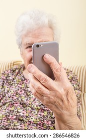 a modern senior woman taking selfie