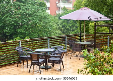 Modern set of outdoors patio furniture in a backyard
