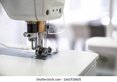Modern sewing machine in tailor workshop, closeup