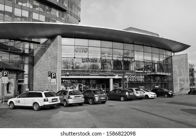 Modern Shopping Center and cars in a parking area. Black White Photography. Glass building. City life. Developing of market in Baltic countries. Lithuania, Vilnius –April 27, 2017