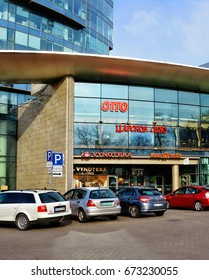 Modern Shopping Center and cars in a parking area. Glass building. City life. Developing of market in Baltic countries. Lithuania, Vilnius - April 27, 2017
