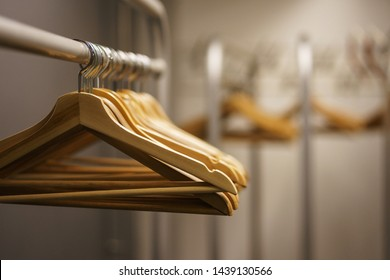 Modern show room selling clothes men, women and children. Empty hangers in a fashion store. Make-up room, storage preparation of costumes. Fashion show, clean empty room for clothes before the event.