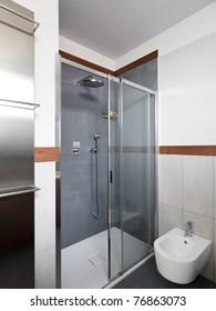 modern shower cubicle with glass door in modern bathroom