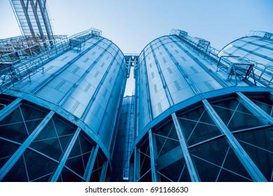Modern silos for storing grain harvest. Agriculture. Background