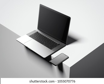 Modern silver laptop and smartphone on the box edge. 3d rendering
