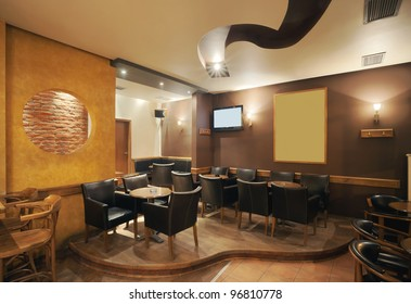 Modern and simple cafe interior with wooden classical furniture.