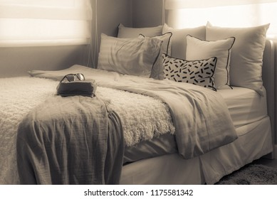 modern single bed in modern bedroom with set of pillows, interior design decoration concept, vintage style process