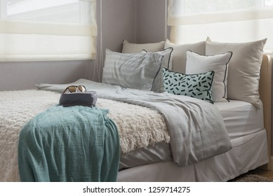 modern single bed in modern bedroom with set of pillows, interior design decoration concept