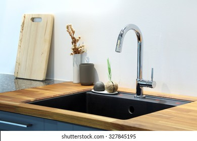 Modern sink with decoration in kitchen room.