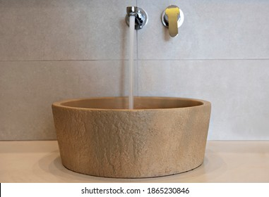 modern sink with the water on