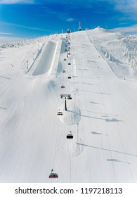 Modern ski chair-lift in Finland Lapland ski resort. Aerial view from above. Drone photography
