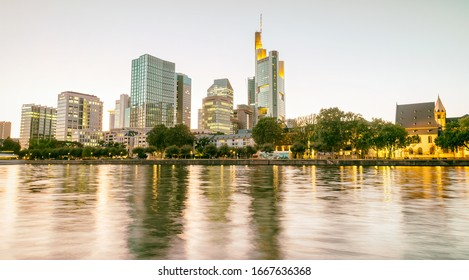 Modern skyline of Frankfurt, Germany. City river and buildings at night.