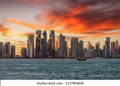 The modern skyscraper buildings of the city center of Doha, Qatar, during sunset