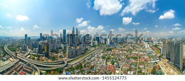Modern Skyscraper and Traditional Housing Area at Kuala Lumpur, Malaysia