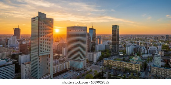 modern skyscrapers in the center of the Polish capital, Warsaw. Sunset sky