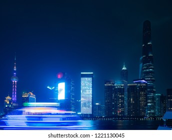 Modern skyscrapers of Shanghai cityscape at night with reflection of beautiful ligth in Huangpu river view from the bund, Shanghai, China