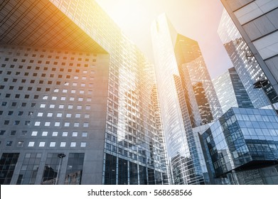Modern skyscrapers at sunset with sunlight