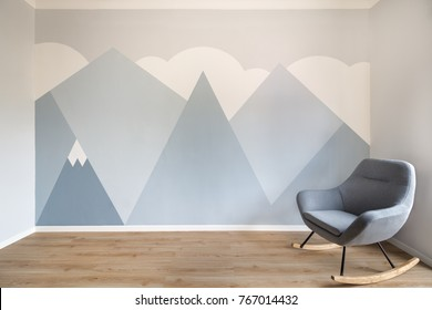 Modern, sleek style room with light oak wooden floor, white skirting and minimalist style mural of mountains. Copy space on the left.