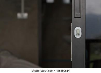 Modern slide glass door's key hole close up
