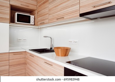 Modern small kitchen in apartment.