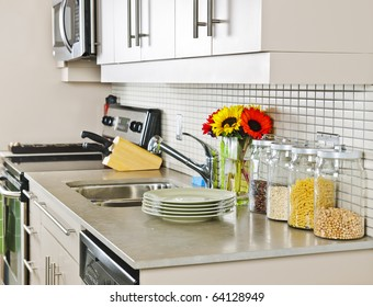 Modern small kitchen interior with natural stone countertop