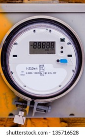 Modern smart grid residential digital power supply meter on grungy base with LCD display ready to be edited for your message