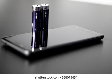 A modern smart phone and battery
