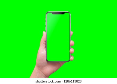 Modern smart phone in hand close-up. Isolated screen and background in green.