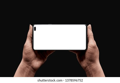 Modern smart phone mockup in horizontal position. Lov light scene of smart phone in woman hands. Concept for video, game or app promotion.