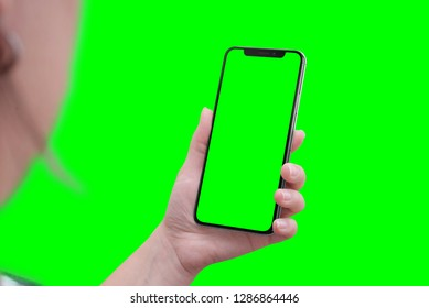 Modern smart phone with round edges in hand. Close-up. Isoalted screen and background in green, chroma key.